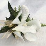 White orchid buttonhole with gold organza ribbon.