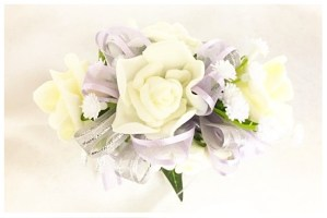 White roses, two ribbons of lilac and grey/silver thread organza, baby's breath added.