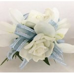 Wrist corsage, mixed orchids and roses, pale blue organza ribbon with silver thread.