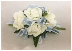 White roses, pale blue with silver thread ribbon, added diamantes throughout.