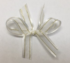 White organza with gold thread.