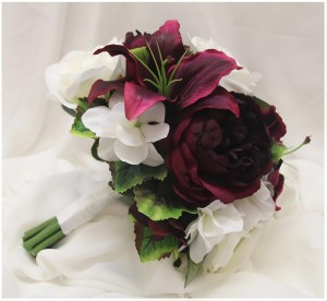 Wine burgundy lilies and peony roses, White hydrangeas and white roses. Grape vine greenery. Natural posy style.