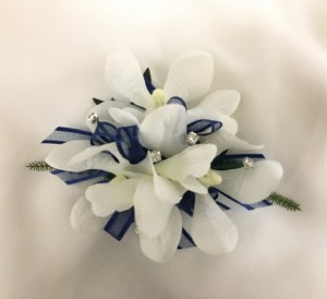 Orchids with navy organza/satin trim ribbon, added silver diamantes.