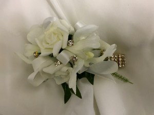 Orchid and rose mix, with ivory satin ribbon, added gold diamantes on a gold diamante wristbands.