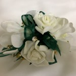 Orchid and rose mix, dark green organza ribbon, added gold diamantes on gold diamante wristband.