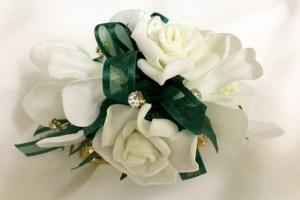 White roses with gold diamantes and dark green organza ribbon, gold diamante wristband.