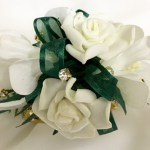White roses with gold diamantes and dark green organza ribbon, gold diamante wristband.