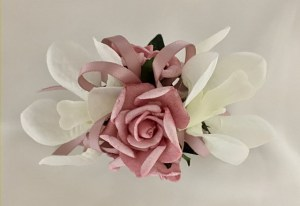 White orchid, pink roses, thin dusty pink satin ribbon.