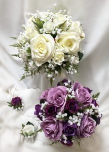 Bridal party in natural posy style using mix of open, semi open and closed roses, and greenery.
