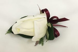 White rose buttonhole with burgundy thin satin ribbon.