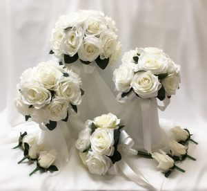 Wedding party flowers. Formal posy style using open white roses.
