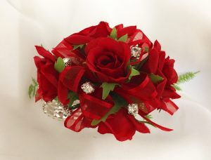 Bright red roses with matching bright red organza ribbon with silver diamantes.