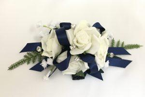 White roses, silver diamante`s, baby's breath, navy satin ribbon wrist corsage.