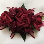 Deep red roses with burgundy organza ribbon.