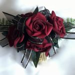 Deep red roses, black organza ribbon with gold thread on gold elasticized wristband.