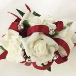White roses, dark red ribbon, silver diamante`s.
