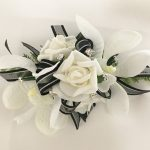 White rose and orchid mix, black organza with silver thread ribbon, added silver diamante`s.