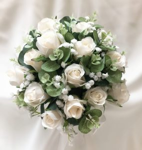 Bridal posy with cream roses, gum leaves and baby's breath.