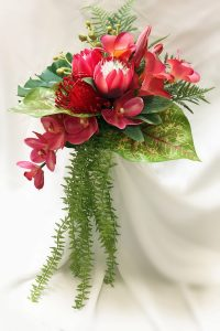 Modern Australian modern tropical bouquet. Asymmetrical trailing bouquet.