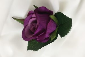 Purple rose buttonhole.