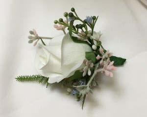Cottage buttonhole with white rose and micro flowers.