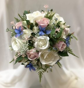 Cottage bridal posy. Using mixed roses, hyacinths, white,pink and blue micro flowers.