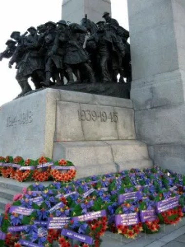 Remembrance Day memorial with wreaths and poppies