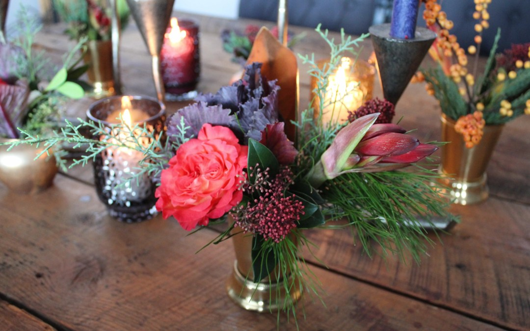 Beautiful holiday centrepieces on wooden table for Christmas by Flowers Talk Tivoli