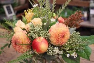 In this arrangement above we incorporated crabapples with dahlias, white waxflower, peach spray roses, Salal, grevillea and seeded eucalyptus.