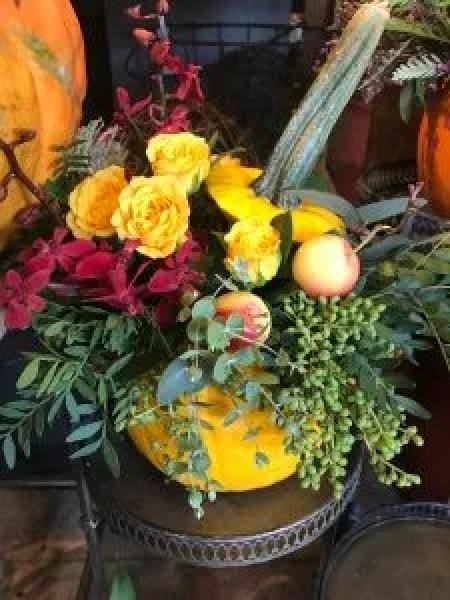 Thanksgiving Holiday Decor! pumpkins with added in florals, mix of crap ales, berries, spray roses and greenery