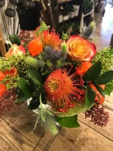 Thanksgiving Holiday Decor! mixed thistle with free spirit roses, skimmia, Chinese lantern and orange pincushion protea