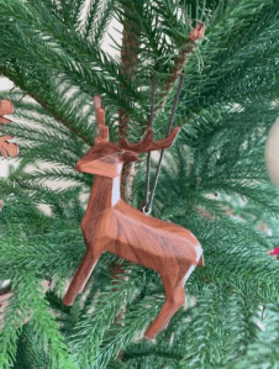 wooden deer in tree