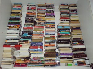 Books behind the bed by zimpenfish via Flickr