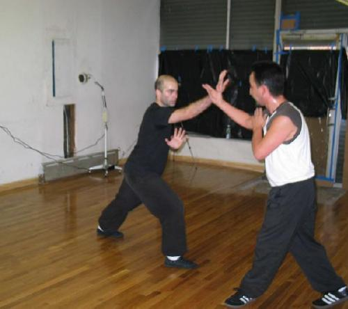 An old image of me doing kung fu drills with a friend