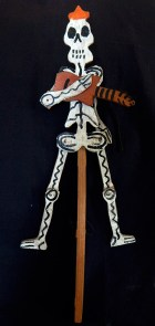 Movable skeleton with guitar