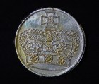 Reverse side of coin with crown and cross