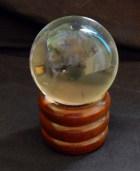 Crystal ball on stand