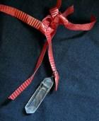 Crystal hanging from ribbon