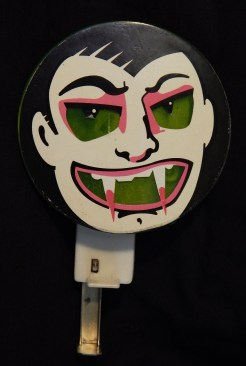 Noisemaker with image of vampire
