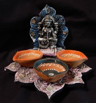 Lord Ganesha with offering bowls