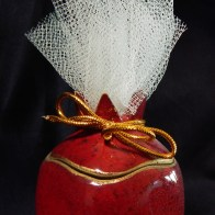 Pomegranate container with Jordan almonds in netting
