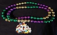 Mardi Gras beads with house trailer pendant