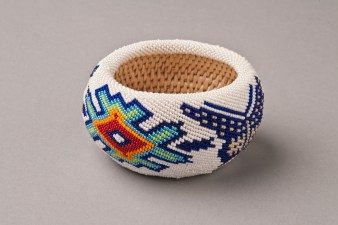 Eagle-Lambert is a prolific weaver and creative beader. She received a Nevada Governor's Arts Award for Excellence in folk art.