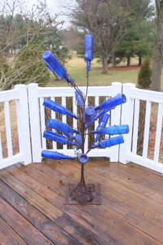 Decorative bottle-tree created by artist Chris Radus, inspired by traditional Southern yard-art.