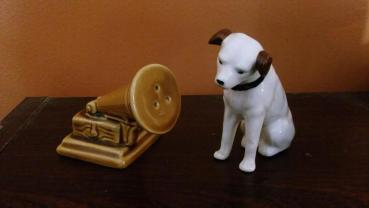 """I inherited these from my father, Tom Noonan, who worked in the music business, and who collected music business memoribilia. He had a large Nipper (about 3 or 4 feet high, which now belongs to my nephew), a smaller one (about 10"""", which I have), and this salt and pepper shaker set."""