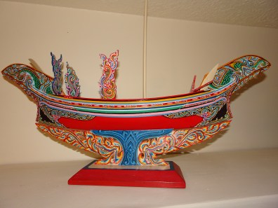"Malay fishing boat model; Southern (peninsular) Thailand Wood and paint, 21"" long x 15"" tall to top of mast, commissioned 1986."