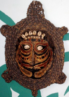 "Sepik River Region, Papua New Guinea 20th century Tortise shell, cowrie shells, raffia 14"" x 9"""