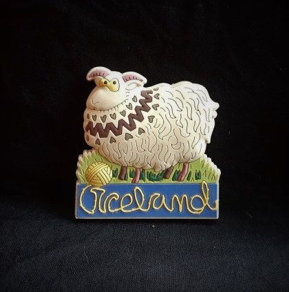 "Purchased in Reykjavíc 2016. Materials: plastic, magnet. Dimensions: 2.5"" x 2.5"" The utter silliness of this plastic sheep magnet drew me in when I was visiting Reykjavík. If an Icelandic sweater is out of your budget, why not buy a magnet of a sheep wearing an Icelandic style sweater?"