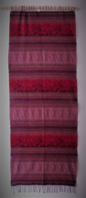 "Tibet/India (?). Wool. Dimensions: 69""x26.5"" (175cm x 67cm) This shawl was sold to me in Los Angeles in 2011 as 'Tibetan'. My investigations so far have revealed very scant information except that it appears to be machine made and is possibly the work of Tibetan workers in India. Again, I would greatly appreciate it if any visitors to the Gallery could enlighten me on any aspect of this piece."