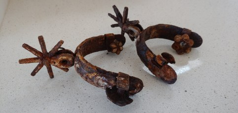 Western spurs, engraved and embossed metal possibly steel, already old when received as a gift in 1957.